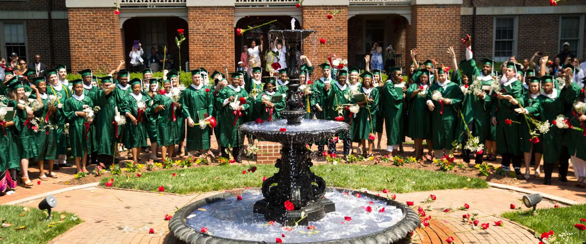 Every year, student throw their graduation roses into the historic Main Fountain