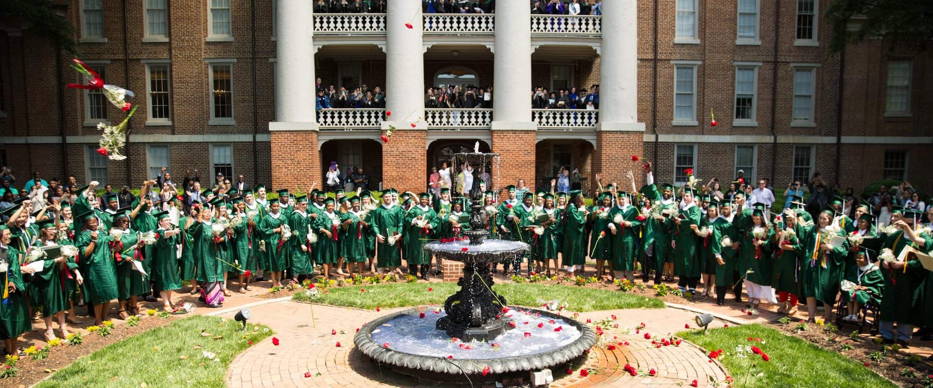 Every year, students throw their graduation roses into the historic Main Fountain
