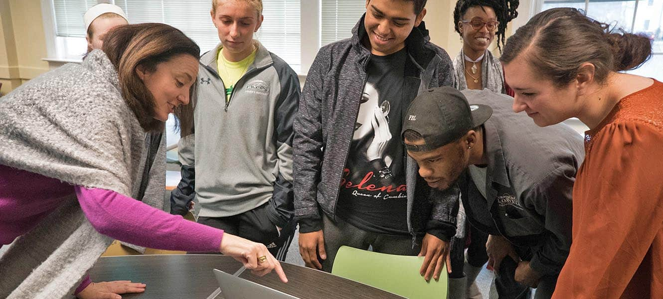 Students work with faculty within the Leadership & Nonprofit Administration Program