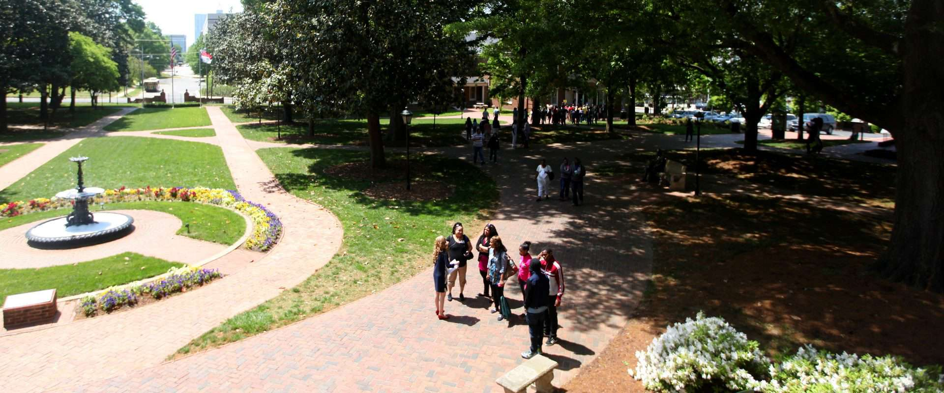 A photo of Students in front of Main Building from one of the building's balconies.