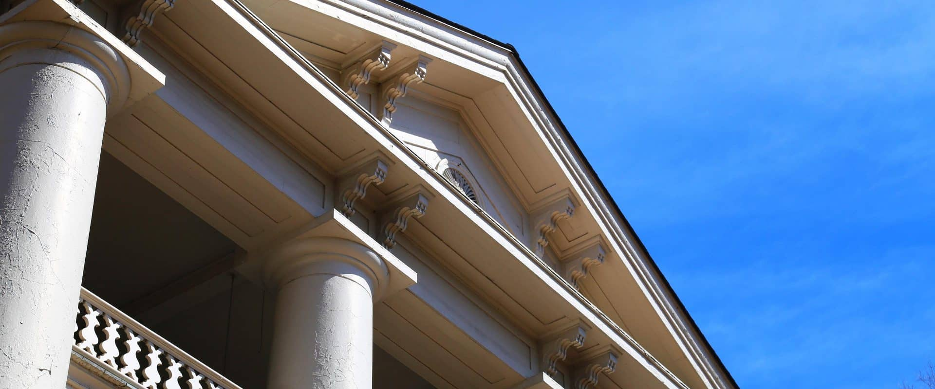 An upward angle of the columns of Main Building.