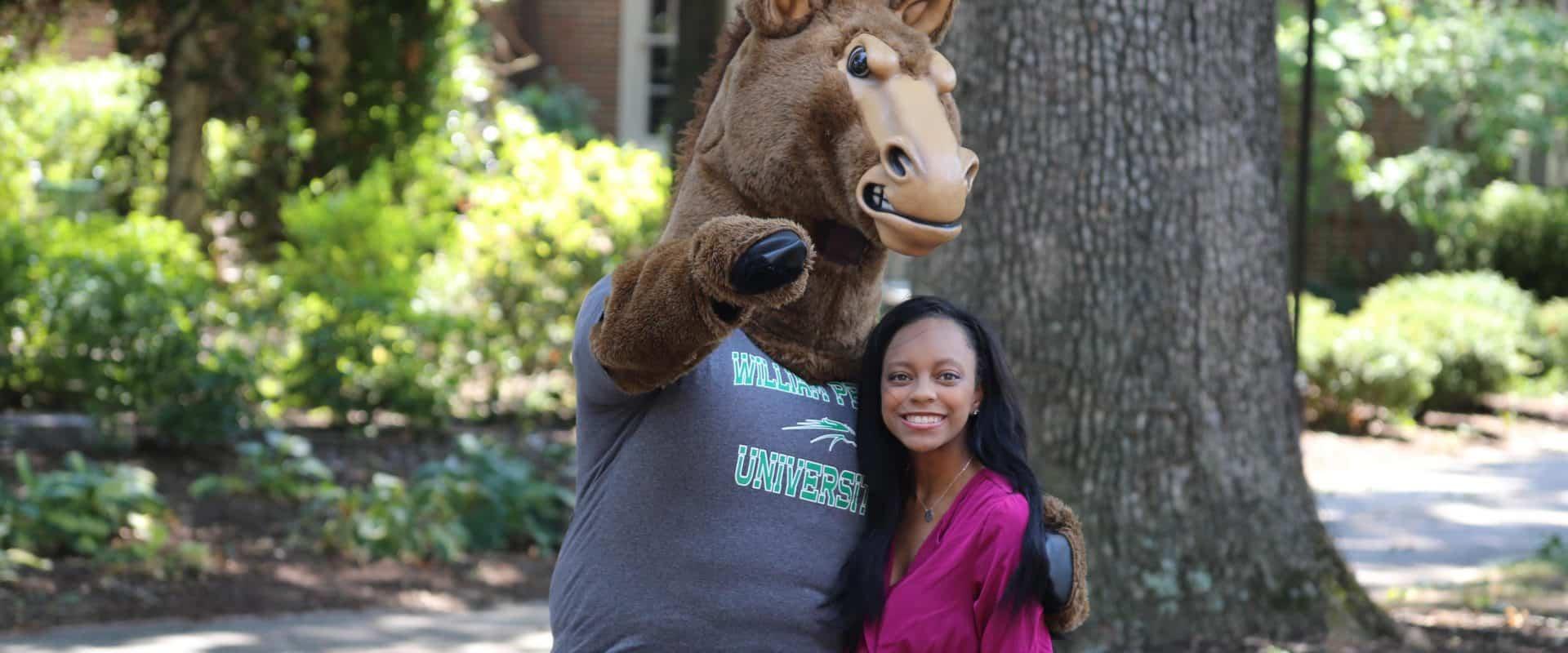 Alumna Maya Bryant with WPU mascot, Phantom.